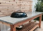 Cedar Wood Outdoor Kitchen With A Concrete Countertop And Built In with regard to size 1000 X 1334