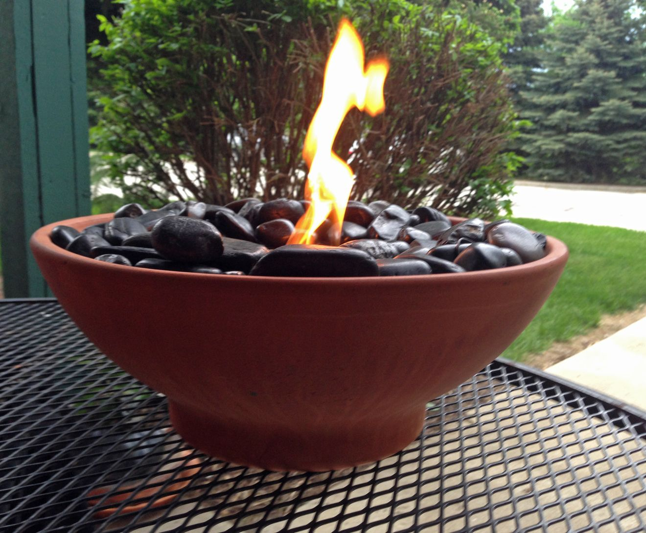 Diy Table Top Fire Pit Made With Black River Rocks And Real Flame inside sizing 1320 X 1089