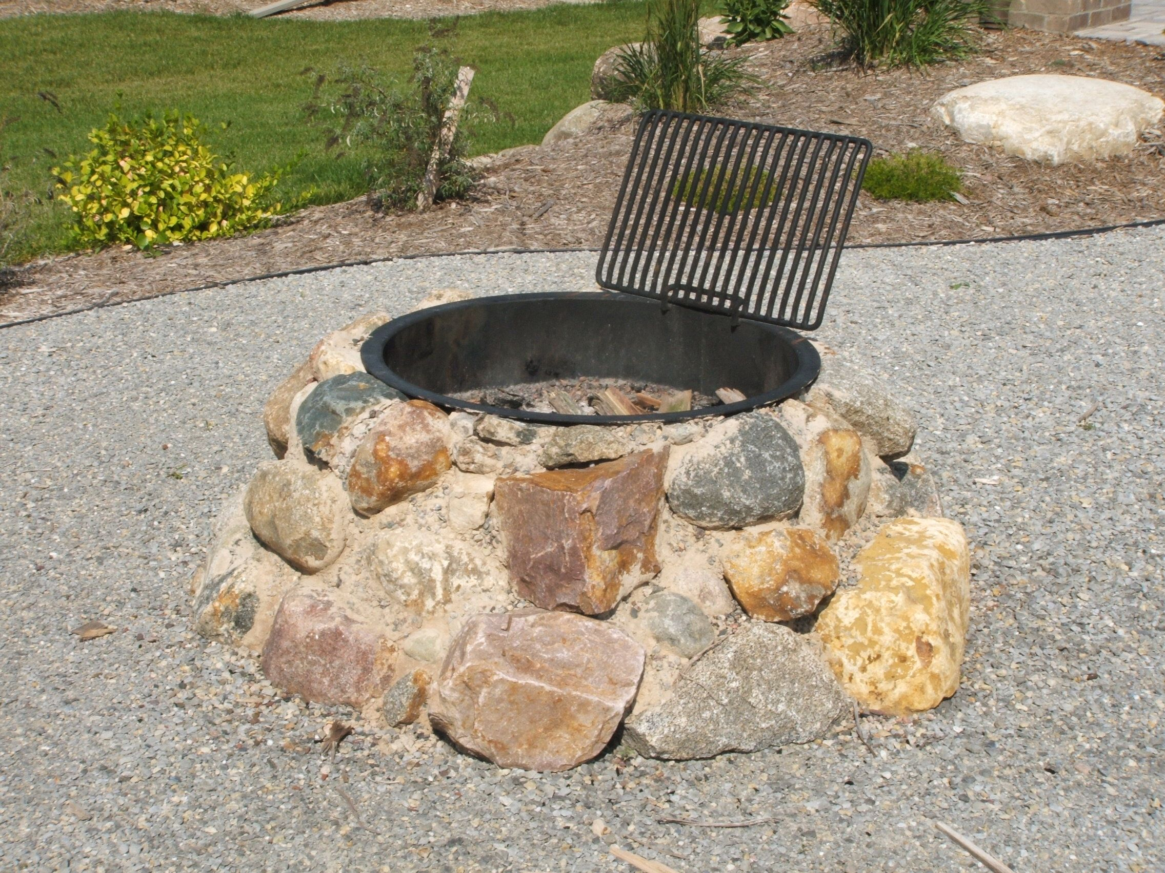 Field Stone Firepit Fire Pit Using Granite Boulders Built Into with regard to measurements 2272 X 1704