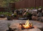 Fire Pit In Sand Boulders Boulder Fire Pits Google Search Home intended for dimensions 736 X 1107