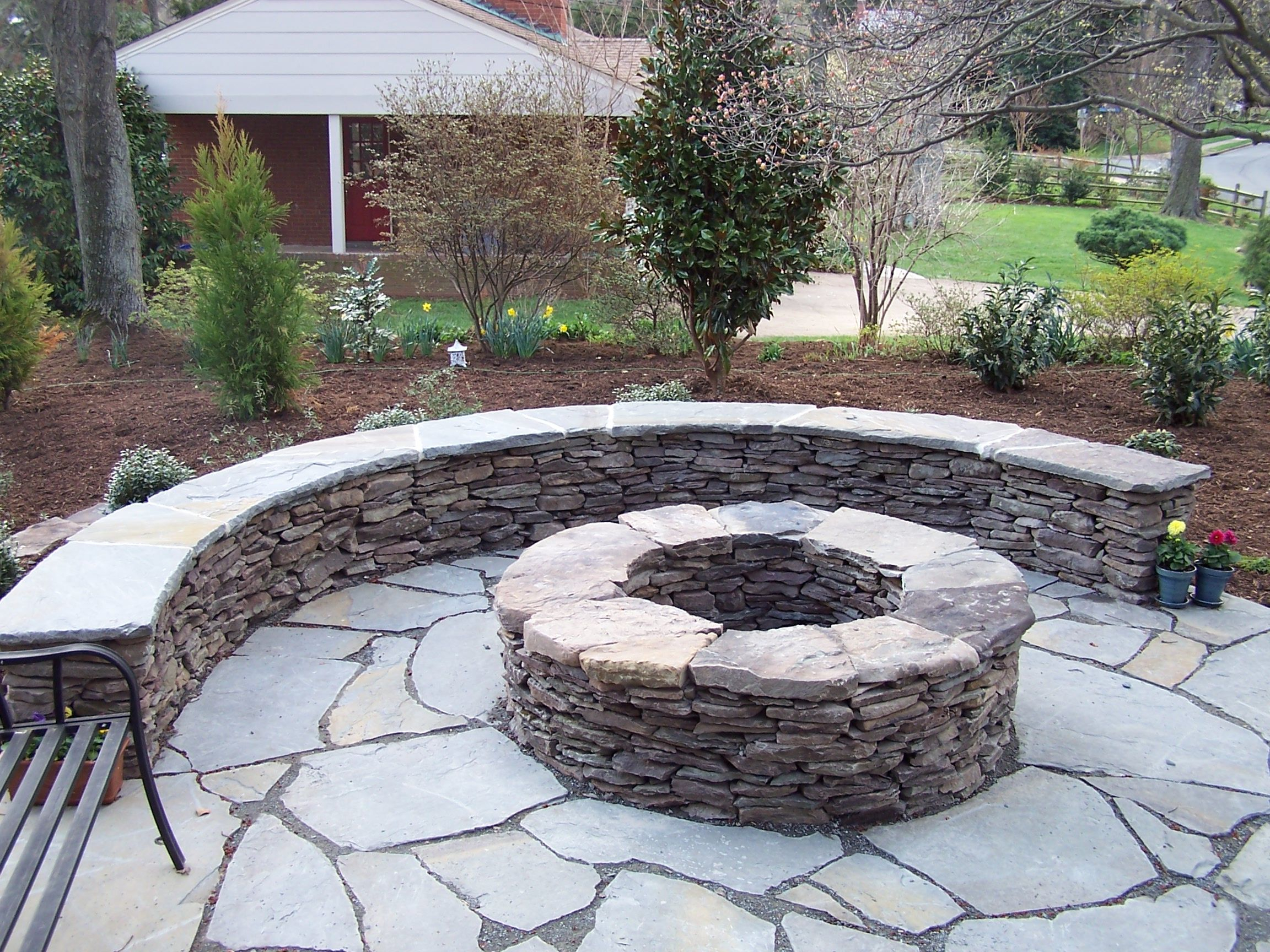 Firepit This Uniquely Shaped Brick Veneered Fire Pit In throughout sizing 2304 X 1728
