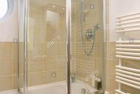 Folding Glass Shower Doors On Bath In Modern Bathroom With Neutral regarding dimensions 1057 X 1390