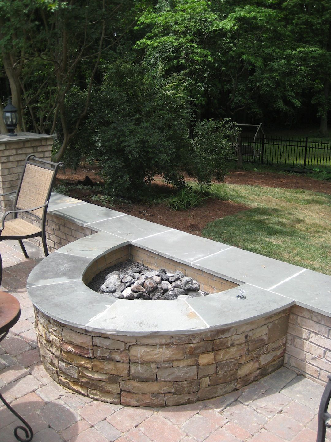 Half Circle Stacked Stone Firepit Fireplaces And Firepits regarding measurements 1080 X 1440