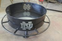 Notre Dame Fire Pit 36 With Boot Rest Custom Metal And Wood regarding dimensions 2133 X 1199