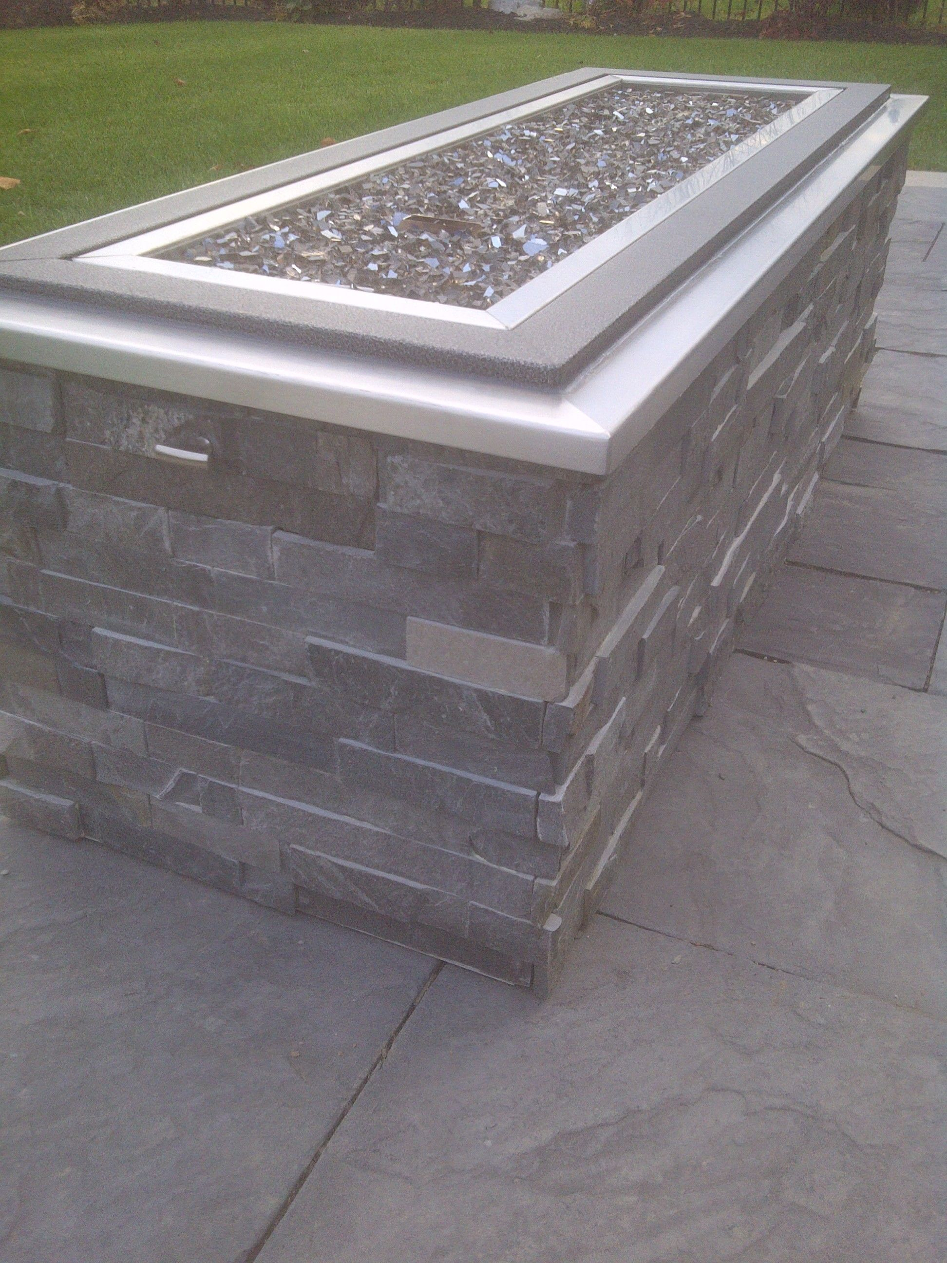 Raised Gas Fire Pit With Crushed Glass Stone Cladding And Stainless with regard to measurements 1944 X 2592