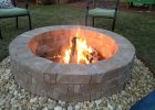 Rumblestone Firepit With River Stone Surround And Red Lava Rock with proportions 3264 X 2448