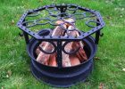 Western Fire Pit Made Out Of A Tire Rim Horse Shoes And Fence Posts for dimensions 1000 X 1000